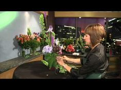 """Fantastic floral design how-to video!  She does a great job describing the """"why"""" of good design (balance, scale, proportion, shape, etc) rather than promoting the nebulous idea of placing features in way that just """"feels right."""" ▶ Vertical Arrangement - GWC Floral Design with Gail Call AIFD - YouTube"""