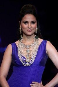 Diamond and emerald encrusted neckpiece by Birdhi Chand Ghanshyamdas.