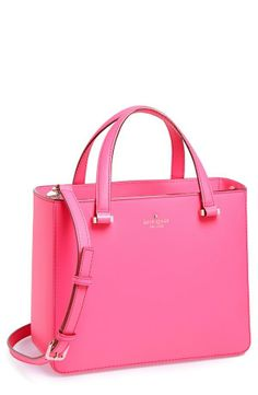 The Pink Tote by Kate Spade is adorable. It is such a beautiful shade of pink and looks stunning with a classic white shirt and and faded jeans .