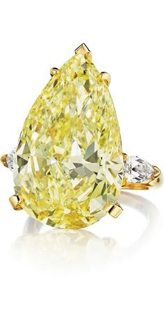 GABRIELLE'S AMAZING FANTASY CLOSET | Yellow Pear Cut Diamond Flanked By 2 White Pear Cut Diamonds Set In Platinum & Yellow Gold Ring |