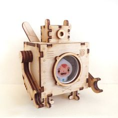 Wooden - Robot Toy Design 9.5 cm length - plywood material, round glass window with metal frame. Thanks