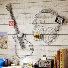Wire Music Decor Sturdy metal wire is artfully shaped in a mix of twists, loops and lines to re-create two of the music lover's favorite things. The sculptural design brings dimension to these rocking wall displays.