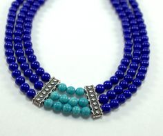 """This handmade necklace consist of blue and turquoise beads with silver accents. Style Includes: - 6mm synthetic turquoise- dyed blue - 8mm synthetic turquoise - Silver accent spacers - Silver Chain w/ lobster claw clasp - 24"""" in length - Handmade in Minnesota Material Synthetic turquoise, Zinc, metal, alloy, stainless steel wire, iron"""