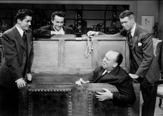 "Farley Granger, John Dall, James Stewart and Alfred Hitchcock on the set of ""Rope"""
