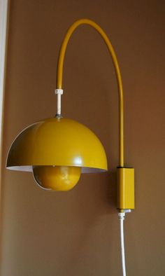 """The yellow coloured wall lamp """"Enamel Flower Pot"""" designed by the Verner Panton from Lampe Spot, Plug In Wall Sconce, Exterior Light Fixtures, Wood Floor Lamp, Mid Century Lighting, Mid Century Modern Furniture, Danish Design, Wall Design, Lamp Light"""