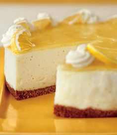 Lemon Curd Mousse Cake Recipe at Epicurious.com  Curd  2 1/3 c sugar      4 t cornstarch      1 c fresh lemon juice      4 large eggs      4 large egg yolks      3/4 c (1 1/2 sticks) unsalted butter, cut into 1/2-inch cubes  Crust  2 c shortbread cookie crumbs (about 7 1/2 oz)      1/4 c (1/2 stick) unsalted butter, melted  Mousse  5 T water      4 t unflavored gelatin