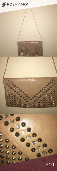 Tan, gold and gemstone studded clutch Super cute, never used clutch big enough for a larger wallet, phone and  make up. Tan color with exchangeable gold chain strap. Embellished with gold spiky studs and white rhinestones. Bags Clutches & Wristlets