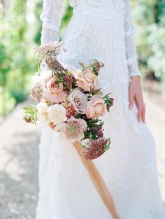 romantic wedding inspiration from the south of France! This dreamy shoot set at a stunning villa in Provence features a gorgeous beaded gown, pale pinks blooms by Flower and Twig and the most unique pair of wedding shoes we've ever seen - strappy pink sandals with an oversized peony at the ankle