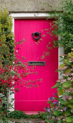 ^An amazingly bright hot pink door in Shaftesbury, Dorset, England.