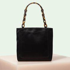0c09ca57fd19 Edie Parker designer handbag Mini Tote in black satin with acrylic tortoise  top handle chain.