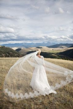 How picturesque is this photo, and the sweeping veil, pure beauty: http://www.stylemepretty.com/little-black-book-blog/2014/12/10/rustic-summer-wedding-at-ranch-at-rock-creek/ | Photography: Christian Oth - http://christianothstudio.com/