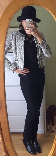 Growing to the ballet. Black pants with Chanel jacket and leather booties.
