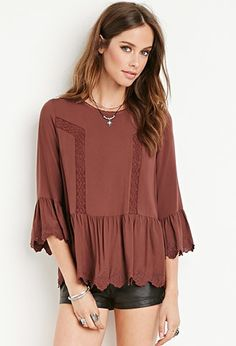 crochet-trimmed boho blouse with flared sleeves
