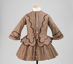 Image 1 of 2: Dress, 1850–55; American: wool, silk Dimensions: Length at CB: 22 in. This is nice, well-made example of a stylish boys garment from the period when both boys and girls wore dresses as toddlers. During this time it was considered a coming of age when boys could graduate to wearing pants.