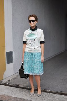 Geeky-chic look by Marni | midi skirt and priest-collar graphic tee. Trés Cool.