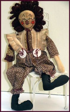 Bruce Sunshine - Handmade Primitive Clown Doll  http://lindawalshoriginalsdolls.net