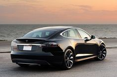 Company chips in and buys their boss a new Tesla Model S. Would you buy your boss a new car?