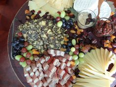 Classic cheese & charcuterie board with dried fruit & accoutrements.