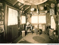 The interior of the Rubydeaux, a Japanese tea house at Totem Place in West Seattle, the family home of the founder of Ye Olde Curiosity Shop. J.E. Standley named the structure for his daughter Ruby in 1909. This photo dates from around 1911.