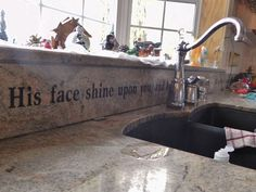 Bible verses around the house --this one is etched in granite ! there is also one in Hebrew