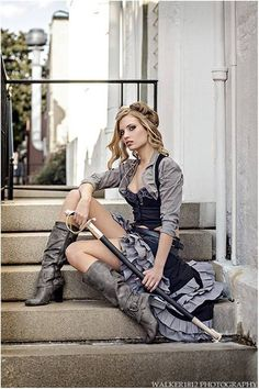 Beautiful steampunk grey bustle dress. I had to do a double take to see that as a cane.