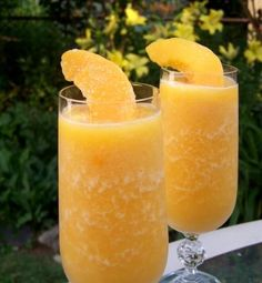 Frozen peach bellini: blend 6 oz. champagne, 1oz. peach schnapps, 1 can frozen Bacardi peach daiquiri mix and ice. YUM!