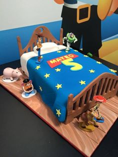 Amazing Toy Story birthday cake, inspired by a free printable birthday front door sign. The entire bed and quilt are edible!