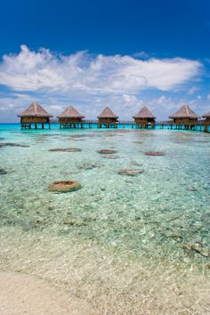 Photo about Beautiful tropical resort overwater bungalow and turquoise warm waters in tahiti. Places Around The World, Oh The Places You'll Go, Travel Around The World, Places To Travel, Places To Visit, Around The Worlds, Beautiful World, Beautiful Places, Beautiful Scenery