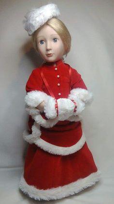 Amelia in a Christmas bustle dress using a thimblesandacorns pattern