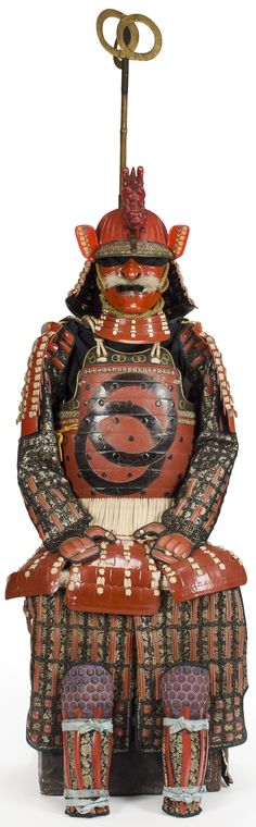Thirty-two plate suji kabuto, nimai yokohagi okegawa Edo period (18th century), nara menpo, chusode; Echu gote; Echu haidate; shino suneate, mounted with a sashimono standard of gilt leather interlocking ring heraldic crest.