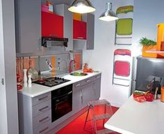 Colorful small-space kitchen. Great folding chairs and table (right lower corner)