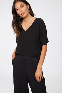 The Charlotte is the perfect piece to take you from day to night featuring a flattering v neck and short sleeves. Made using 100% viscose, a planet-friendly fabric made from wood pulp with a silky hand-finished feel – our Charlotte Top is the ideal wardrobe companion this season. Perfect to tuck into high waisted pants and skirts for work and play, you won't struggle to wear this staple piece. Viscose V neck Short sleeve Material: 100% Viscose Latest Fashion For Women, Womens Fashion, Work Skirts, Staple Pieces, V Neck Tops, Black Tops, Charlotte, Short Sleeves, How To Wear