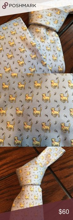 """Retired  Golden Retriever Vineyard Vines Silk Tie This light blue tie is an excellent condition like new from a non-smoking household 100% silk retired rare vineyard vines tie Martha's Vineyard collection.  Features yellow golden retriever playing with a ball. Non-smoking household. Regular length 59"""". Perfect Christmas gift Vineyard Vines Accessories Ties"""