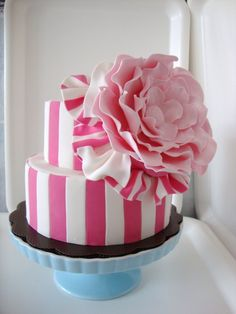 Pink and White Stripe Cake with a Big Flower on the side.