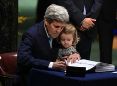 John Kerry served as U. Sec'y of State under Barack Obama from Here Kerry holds his granddaughter while he signs the Paris Climate Accord. New York Protest, Paris Climate Change, Military Records, The Lives Of Others, Environmental Issues, Presidential Candidates, Earth Day, United States, Climate Change