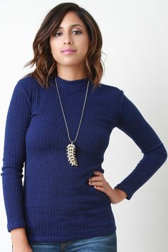 This sweater top features a ribbed knit fabrication, mock neckline, and long sleeves design. Accessories sold separately. Made in U.S.A. 95% Polyester, 5% Spandex. Measurement Size Bust Hem Length Sle