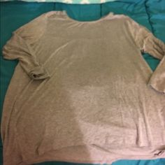 XL Grey Top With Jeweled Back XL grey Tshirt top, long sleeve.  Back has metal accent jewels on the top portion.  Has slight hi-lo effect.  In great shape.  Important:  I make sure all items are freshly laundered as applicable (shoes and tagged items, I don't remove the tags and wash).  However, not all my items come from pet/smoke free homes.  Low pricing reflective of this. Thank you for looking! Faded Glory Tops