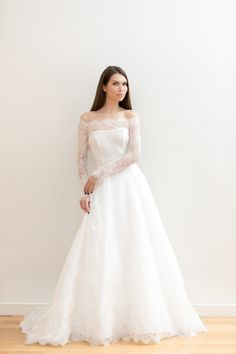 This wedding dress by Elisabetta Polignano. is from the designer's Spring 2018 collection. The dress features an off-the-shoulder look, lace sleeves and a flattering a-line silhouette.