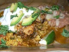 Chicken, Green Chilli, Onions, Garlic, Beer, Stock,  Avocado, Sour Cream, Cilantro, Spanish Rice with Tomato, Habanero, Frioles