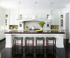 Love the wainscoting on the island. And similar bar stools would keep the family room/kitchen from looking cluttered.