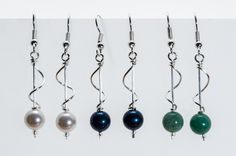 Wave Earrings: Elegant and playful. Hand twisted silver wire dances with semi-precious stones, pearls and beads in these hand crafted earrings from Mongolia. Colors vary. Call if you would like a specific choice or we will choose for you. Fair Trade. $12.