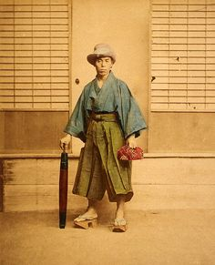 Shosei / Calligraphy student with a paper umbrella and bento wrapped in furoshiki by Baron Raimond von Stillfried ...a funny cowboyish hat