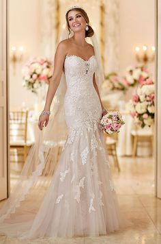 Standout lace appliques on fine tulle work together to create a stunning wedding dress from Stella York.
