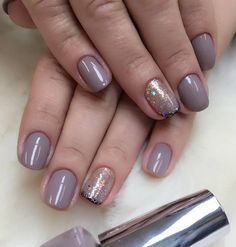 Very beautiful length of nails. When you do not know how to give a special stamp to your manicure just one nail on both hands decorate with rhinestones.