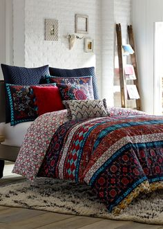 Coordinating shams feature vibrant embroidery to complete the festive look of this bedding that's inspired by the colorful, hand-painted tiles of Mexico City.