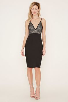 A knit bodycon dress with cami straps, a V-neckline, a V-back, and circle-patterned lace at its bodice.