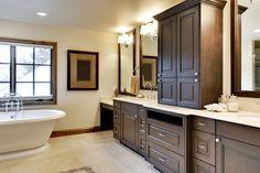 Bathroom with pedestal tub and custom cabinet vanities