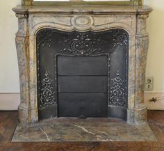 #Antique #Pompadour #fireplace in Rose Enjugerais #marble with its cast iron insert  #19thcentury  #frenchantiques #interiordecoration #black #decor #design #louis15 #french #style Available on #MarcMaison website