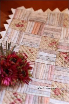 Adorable mini quilt in shabby chic. Of course it's hand quilted.