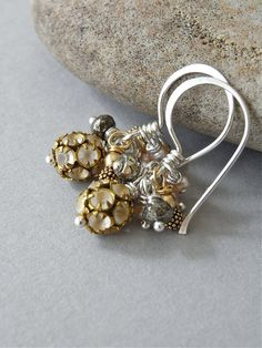 The Blondelle earrings - unusual matte crystal studded earrings are accompanied by pyrite, goldfill rouns on vermeil headpins, and teensy pale pink freshwater pearls - all housed on handforged ear wires.